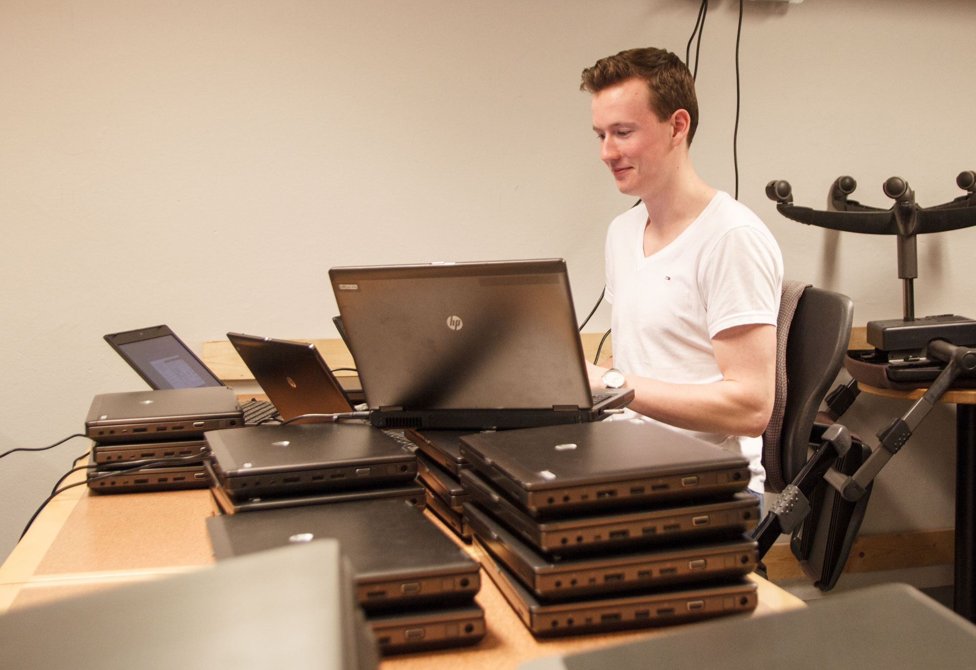 Daniel working with five computers at a time.