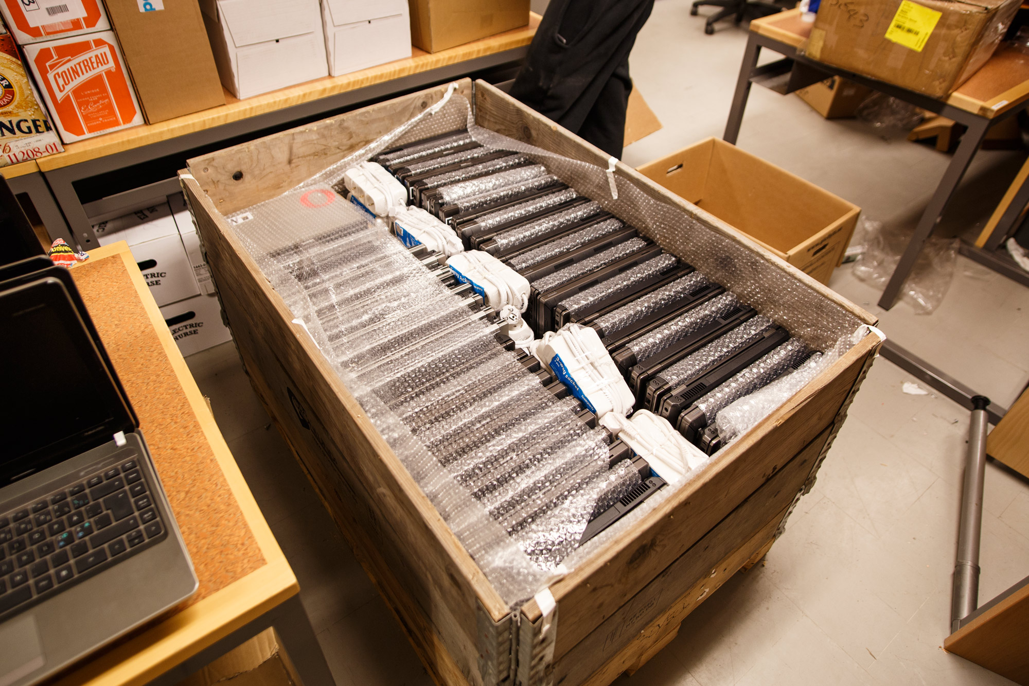 The computers being packed on the pallet.
