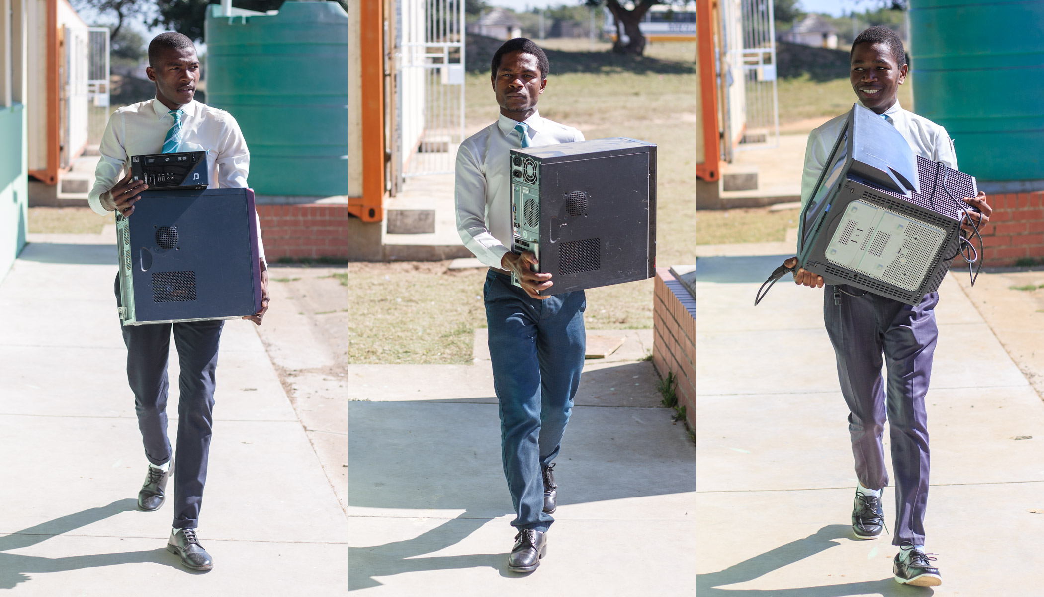 Learners carrying some computers at Gilonki Secondary School.