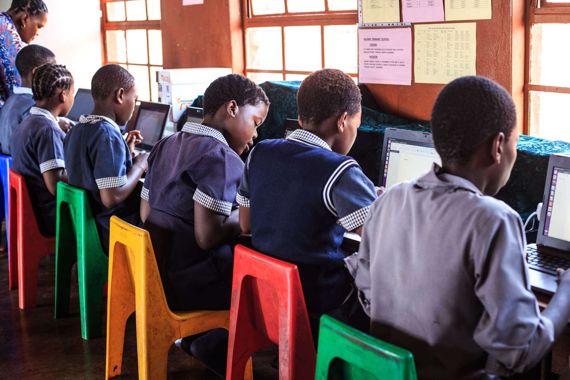 Learners using their computer skills at Majindi Primary School.